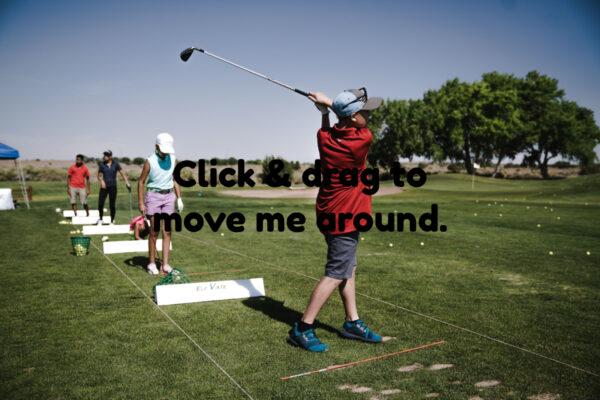 Practising On The Golf Driving Range